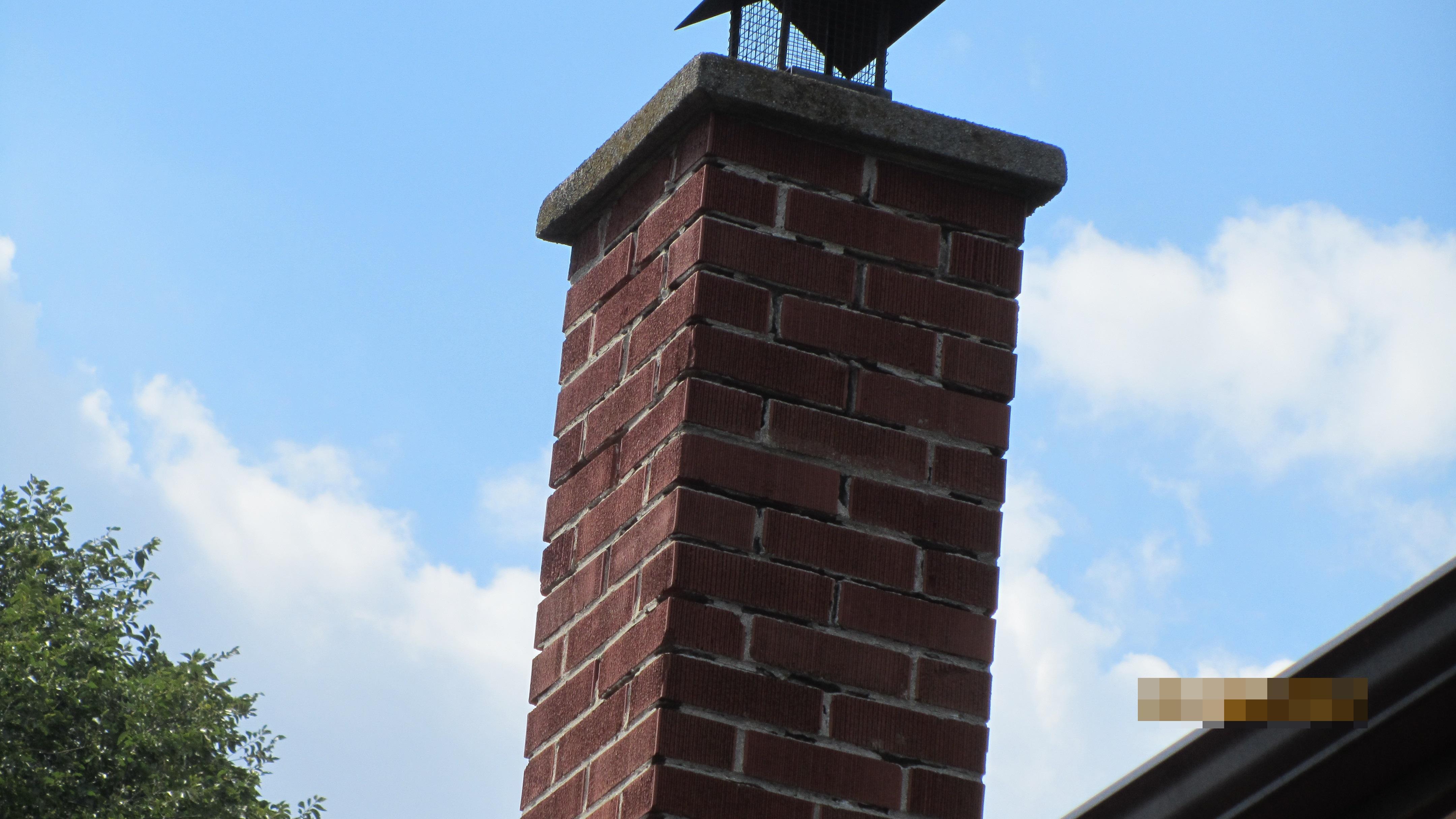 Masonry chimney mortar missing, safety hazard